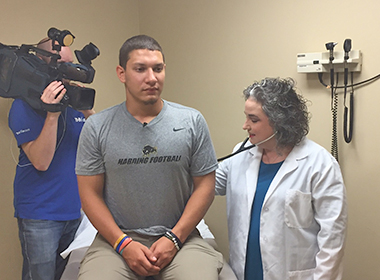 Routine Exam with Dr. Rachel White Uncovers a Herniated Disc in a Cabot Football Player